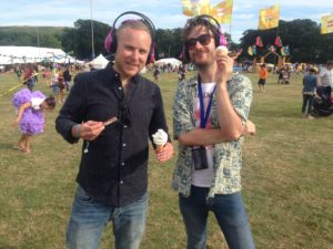 Wearing now>press>play pink wireless headphones at Camp Bestival