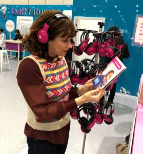 Sian Reeves wearing now>press>play pink wireless headphones