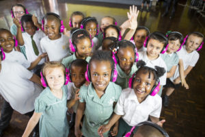 Children wearing now>press>play pink wireless headphones