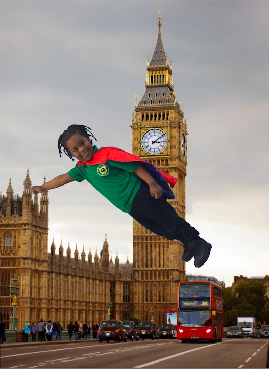 A child dressed as a superhero flys above the Houses of Parliament