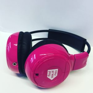 A pair of pink now>press>play headphones.
