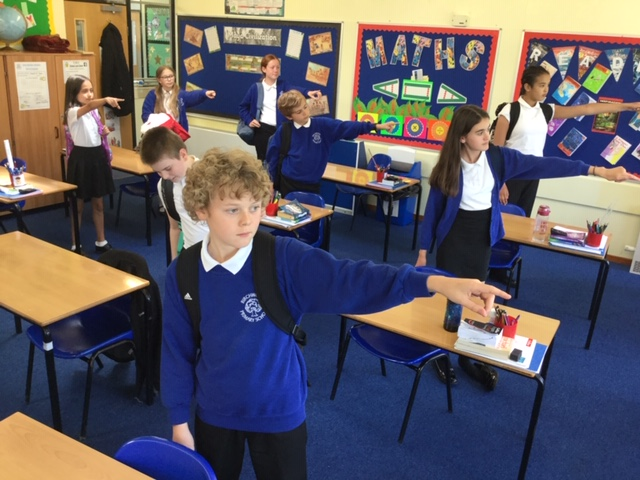 Children practicing actions about to start their transition project