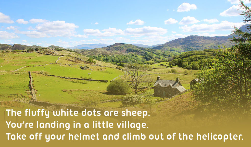 Snowdonia in Wales to illustrate the differences between different countries in the UK, text reads 'The fluffy white dots are sheep. You're landing in a little village. Take off your helmet and climb out of the helicopter.'